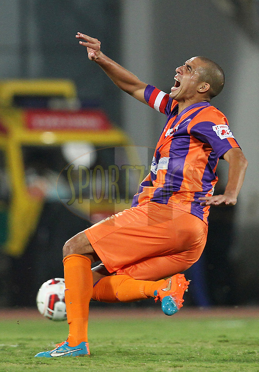 David Trezeguet of FC Pune City reacts after being tackled during match 17 of the Hero Indian Super League between FC Pune City and Kerala Blasters FC held at the Shree Shiv Chhatrapati Sports Complex Stadium, Pune, India on the 30th October 2014.<br /> <br /> Photo by:  Vipin Pawar/ ISL/ SPORTZPICS