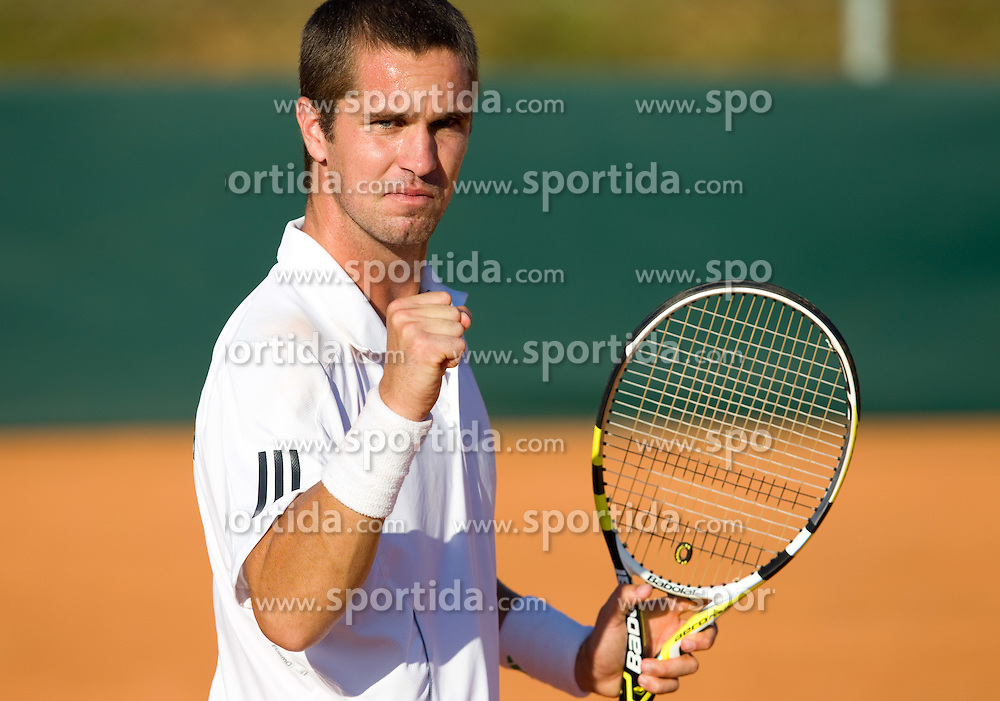 Luka Gregorc of Slovenia reacts during tennis match of 2nd Round of Euro/Africa Group II of the Davis Cup between teams Slovenia vs Bulgaria, on July 10, 2010 at Sports center Otocec, Novo mesto, Slovenia. (Photo by Vid Ponikvar / Sportida)