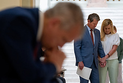 Georgia Gov. Brian Kemp and his wife Marty pray during a prayer service called by Kemp on Monday morning, April 27, 2020 at the State Capitol. Photo by Ben Gray/Atlanta Journal-Constitution/TNS/ABACAPRESS.COM