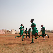 Girls of Les Amazones of Bakodjikoronì (Bamako) warming before second match of a national league. As no professional league, the associations just provide uniforms, soccer balls and means for transfer, often with difficulties