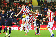 Stoke City's Sam Cluckas (22) wins a header during the EFL Sky Bet Championship match between Stoke City and Derby County at the Bet365 Stadium, Stoke-on-Trent, England on 28 November 2018.