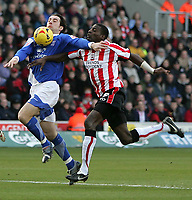 Photo: Lee Earle.<br /> Southampton v Ipswich Town. Coca Cola Championship. 21/01/2006. Ipswich's Alan Lee (L) battles with Darren Powell.