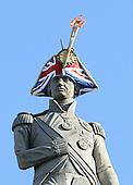Famous statues in London wear hats for charity