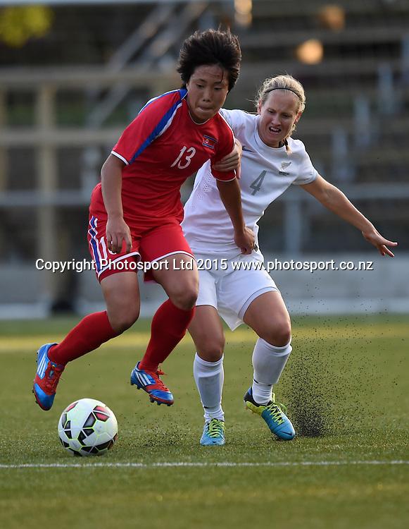 Korea's Jo Yun Mi and Katie Hoyle. Womens Football. New Zealand Football Ferns v Korea DPR. Auckland, New Zealand. Sunday 8 February 2015. Copyright Photo: Andrew Cornaga / www. Photosport.co.nz