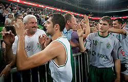 Goran Ikonic and Jan Osolnik of Krka with fans Kelti after the basketball match between KK Union Olimpija and KK Krka in 4th Round of Final of Slovenian Basketball National Championship, on June 9, 2011 in Arena Stozice, Ljubljana, Slovenia. Krka defeated Union Olimpija 63-61. (Photo By Vid Ponikvar / Sportida.com)