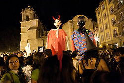 North America, Mexico, Oaxaca Province, Oaxaca, giant puppets and crowd in Zocalo plaza near Cathedral during Day of the Dead (Dias de los Muertos) celebration at night