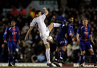 Photo: Jed Wee.<br /> Leeds United v Crystal Palace. Coca Cola Championship. 21/03/2006.<br /> <br /> Leeds' Eirik Bakke (L) is a late substitute for his team, scuffing a loose ball against Crystal Palace's Jobi McAnuff.