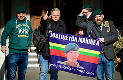 © Licensed to London News Pictures.15/03/2017.London, UK.  A group of former Royal Marines celebrate as they  leave the Royal Courts of Justice in London, where a judge reduced the conviction of Sgt Blackman from Murder to Manslaughter, on appeal.  Also known as Marine A, Sgt Blackman was appealing a life sentence for the murder of a wounded Taliban fighter in Afghanistan in 2011.Photo credit: Ben Cawthra/LNP