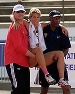 Germany's Annelie Schrader was helped off the track after turning her ankle in the 800-meter run, at the Nike Combined Events Challenge at the R.V. Christian Track Complex on the campus of Kansas State University in Manhattan, Kansas, August 6, 2006.