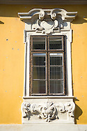 An old window surrounded by ornate carving in the Castle Hill section of Buda,<br /> Budapest, Hungary