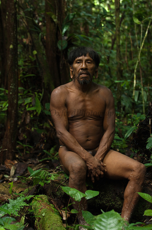 Huaorani man, Me&ntilde;ewa Wane.<br /> Bameno Community. Yasuni National Park.<br /> Amazon rainforest, ECUADOR.  South America<br /> This Indian tribe were basically uncontacted until 1956 when missionaries from the Summer Institute of Linguistics made contact with them. However there are still some groups from the tribe that remain uncontacted.  They are known as the Tagaeri &amp; Taromenane. Traditionally these Indians were very hostile and killed many people who tried to enter into their territory. Their territory is in the Yasuni National Park which is now also being exploited for oil.