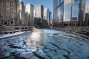 The frozen Chicago River seen from Michigan Ave. in Chicago Monday morning. Temperatures were near zero at the start of the day and expected to fall throughout the day with windchills reaching -25 to -40 degrees.<br /> Photo by Michael R. Schmidt