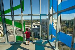 United States, Washington, Bellevue, boy in glass stairwell of Bellevue City Hall  MR