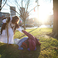 "Michael Grant, 28, ""Philly Jesus,"" helps a homeless man to his feet in Philadelphia, PA on December 18, 2014.  Nearly everyday for the last 8 months, Grant has dressed as Jesus Christ, and walked the streets of Philadelphia to share the Christian gospel by example.  He quickly acquired the nickname of ""Philly Jesus,"" which he has gone by ever since. REUTERS/Mark Makela (UNITED STATES)"