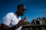 A man poses for a photograph at the Cristo Redentor (Christ statue) at the top of the hill in Rio de Janeiro, Brazil. Photo by Andrew Tobin/Tobinators Ltd