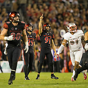 08 October 2016: The San Diego State Aztecs football team open's up the mountain west conference season at home against the University of Nevada Las Vegas Lobos. San Diego State place holder Tanner Blain (91) celebrates after kicker John Baron (29) hits a 50 yard field goal in the second half to give the Aztecs a 13-7 lead at halftime. www.sdsuaztecphotos.com