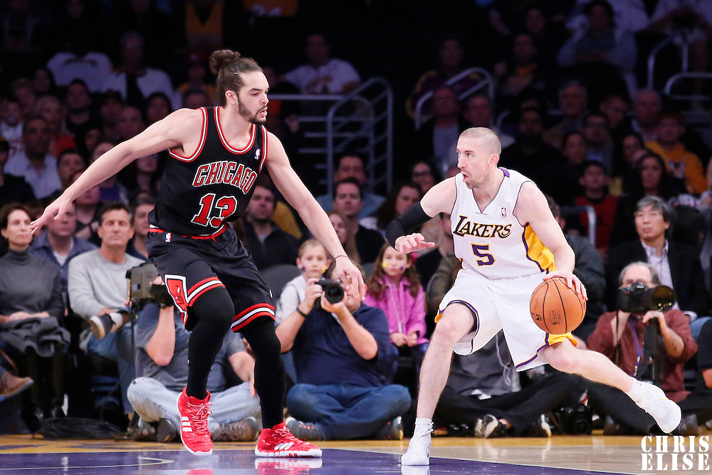 09 February 2014: Chicago Bulls center Joakim Noah (13) defends on Los Angeles Lakers point guard Steve Blake (5) during the Chicago Bulls 92-86 victory over the Los Angeles Lakers at the Staples Center, Los Angeles, California, USA.