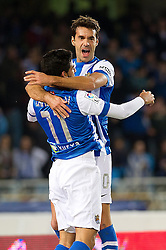15.12.2013, Anoeta Stadium, San Sebastian, ESP, Primera Division, Real Sociedad vs Real Betis, 16. Runde, im Bild Real Sociedad's Carlos Vela and Xabi Prieto celebrate goal // Real Sociedad's Carlos Vela and Xabi Prieto celebrate goal during the Spanish Primera Division 16th round match between Real Sociedad and Real Betis at the Anoeta Stadium in San Sebastian, Spain on 2013/12/15. EXPA Pictures © 2013, PhotoCredit: EXPA/ Alterphotos/ Mikel<br /> <br /> *****ATTENTION - OUT of ESP, SUI*****