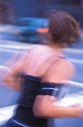 one female jogger crossing city street