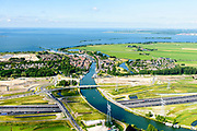 Nederland, Noord-Holland, Gemeente Gooise Meren, 13-06-2017; Muiden, A1 met Aquaduct Muiden (of Aquaduct Vechtzicht). Het aquaduct onder de Utrechtse Vecht is aangelegd in het kader van het project Schiphol-Amsterdam-Almere. Foto richting Muiden.<br /> Aqueduct under river Vecht, neaar Muiden, motorway A1,<br /> luchtfoto (toeslag op standaard tarieven);<br /> aerial photo (additional fee required);<br /> copyright foto/photo Siebe Swart