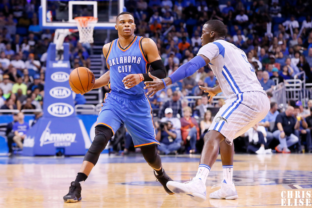 30 October 2015: Oklahoma City Thunder guard Russell Westbrook (0) looks to pass the ball over Orlando Magic guard Victor Oladipo (5) during the Oklahoma City Thunder 139-136 double overtime victory over the Orlando Magic, at the Amway Center, in Orlando, Florida, USA.