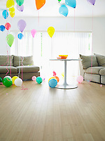Living room full of balloons