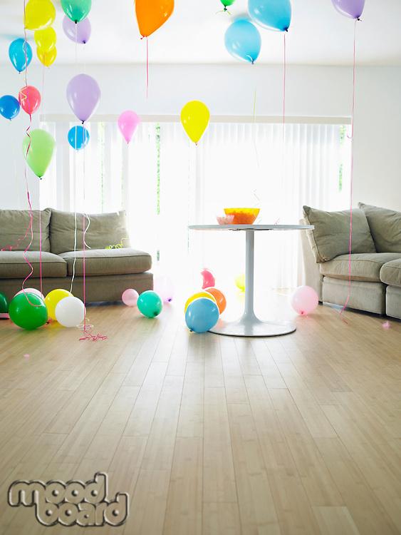 Living room full of balloons