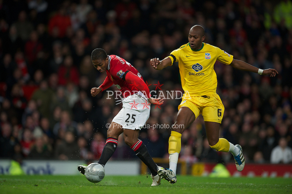 MANCHESTER, ENGLAND - Wednesday, November 29, 2011: Manchester United's Antonio Valencia in action against Crystal Palace's Anthony Gardner during the Football League Cup Quarter-Final match at Old Trafford. (Pic by David Rawcliffe/Propaganda)