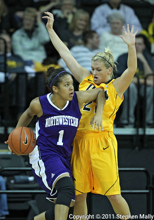 December 30, 2011: Northwestern Wildcats guard Morgan Jones (1) works against Iowa Hawkeyes guard Melissa Dixon (21) during the NCAA women's basketball game between the Northwestern Wildcats and the Iowa Hawkeyes at Carver-Hawkeye Arena in Iowa City, Iowa on Wednesday, December 30, 2011.