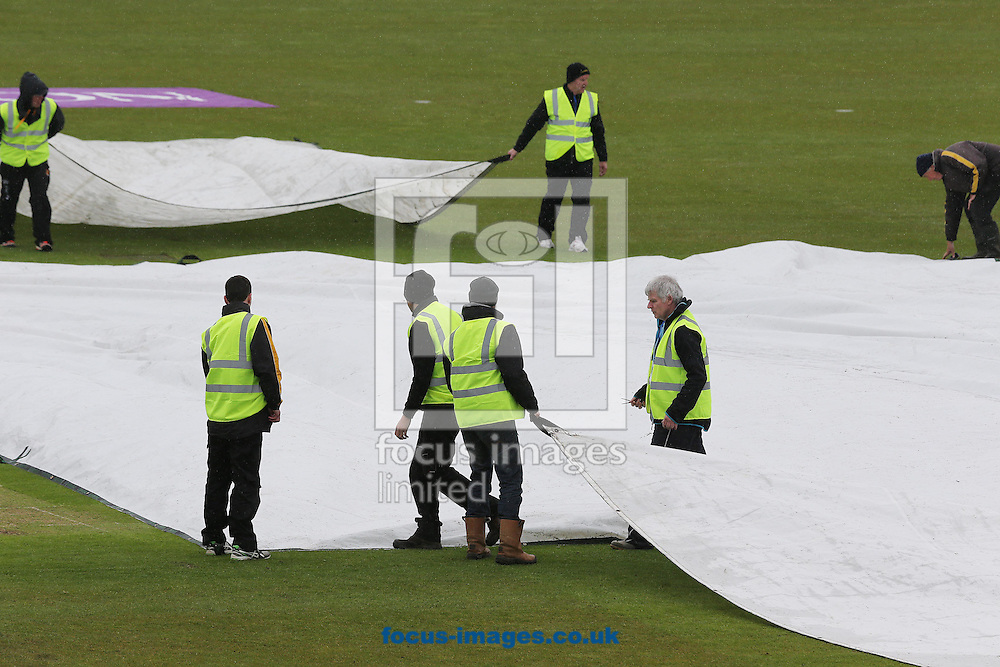 The covers come on in Malahide as rain stops play with Ireland struggling at 56 for 4 during the One Day International match at the Village, Malahide<br /> Picture by Lorraine O'Sullivan/Focus Images Ltd +353 872341584<br /> 08/05/2015