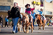 28 JANUARY 2012 - BUCKEYE, AZ:    Children ride ponies in the Buckeye Days parade. The Buckeye Days parade went through downtown Buckeye, AZ, an agricultural community about 45 miles west of Phoenix. The parade was one the first events to mark Arizona's centennial celebration. Arizona was admitted to the United States on Feb 14, 1912, making it the 48th state in the union. The state celebrates its 100th birthday with a series of events on Feb. 14, 2012.    PHOTO BY JACK KURTZ