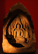Buddha in the Mahabodhi temple, terracotta plaque, eastern India, 1000-1200.  Shown within the temple, surrounded by stupas, the Buddha makes the gesture of touching the earth to bear witness to his Enlightenment.