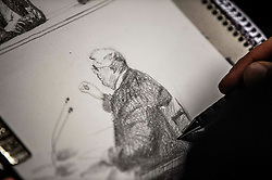 A sketch of the Former MP and leader of Golden Dawn party, Nikolaos Michaloliakos, gestures as he testifies before a criminal appeal court in Athens, on November 6, 2019, as part of a landmark murder trial implicating Golden Dawn<br /> <br /> Pictured: <br /> Dimitris Lampropoulos  | EEm date
