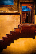 Brightly colored staircase leads to a locked gate in Fatehpur Sikri, India.
