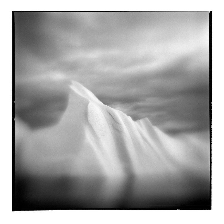 Greenland, Ilulissat, Blurred black and white image of iceberg from Jakobshavn Isfjord in Disko Bay in early summer