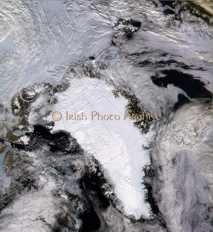 Satellite image of  a snow and ice-covered Greenland in 2000. Credit NASA.