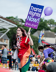 A colourful participant joins the annual Pride Edinburgh march took place from outside the Scottish Parliament.<br /> <br /> © Dave Johnston/ EEm