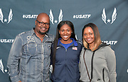 Apr 27, 2018; Philadelphia, PA, USA; Aaliyah Brown (center) poses with father Angelo Brown (left) and mother Lemetria Brown at USA vs. The World press conference during the 124th Penn Relays at Franklin Field.