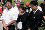 14 SEPTEMBER 2003 - CANCUN, QUINTANA ROO, MEXICO:  The daughter of Lee Kyung-hae (CENTER) weeps during a memorial service Sunday for her father, a Korean farm activist who publicly committed suicide Wednesday in Cancun to protest World Trade Organization agricultural policies, has been built where he died in a park in Cancun. Thousands of protestors opposed to the World Trade Organization and globalization have come to Cancun to protest the WTO meetings taking place in the hotel zone. Mexican police restricted most of the anti-globalization protestors to downtown Cancun, about five miles from the convention center.  PHOTO BY JACK KURTZ