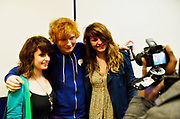 Ed Sheeran posing with young female fans at The Stratford Circus, 19th November 2010