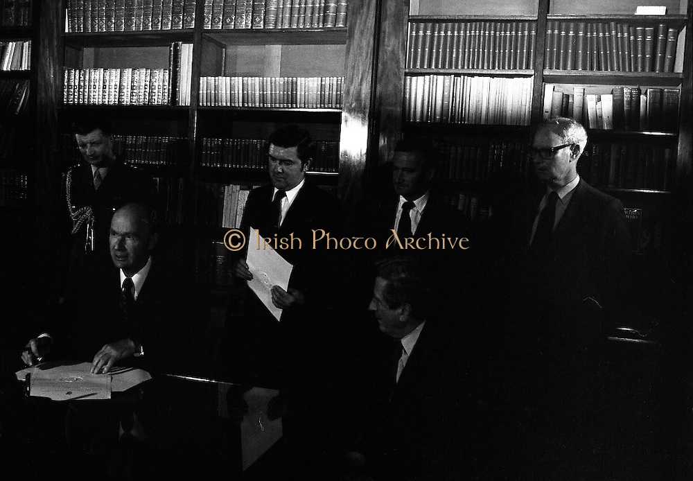 New Government Receive Seals Of Office.   (N84)..1981..30.06.1981..06.30.1981..30th June 1981..The newly elected Fine Gael /Labour coalition government under Dr Garret Fitzgerald received their seals of office from President Hillery at Áras an Uachtaráin today...Picture shows President Hillery signing the order appointing the new government under the leadership of Dr Garret Fitzgerald TD.