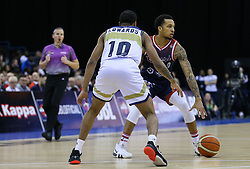 Gentry Thomas of Bristol Flyers trying to find a way past Cortez Edwards of Worcester Wolves - Photo mandatory by-line: Arron Gent/JMP - 26/01/2020 - BASKETBALL - Arena Birmingham - Birmingham, England - Bristol Flyers v Worcester Wolves - British Basketball League Cup Final