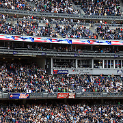 Fans and players sing 'God Bless America' during the seventh inning stretch during the New York Yankees V Detroit Tigers Baseball game at Yankee Stadium, The Bronx, New York. 28th April 2012. Photo Tim Clayton