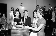 At the release of a Jim Reeves tribute disc by the Mighty Avons showband, lead singer Larry Cunningham, from Granard, Co Longford is pictured with (l to r) Miss Pauline Walker, Monaghan, Miss Phyllis Mortimer, Enniskillen, and Miss Mary Mullen, Kiltegan, Co Wicklow.  .16.11.1964