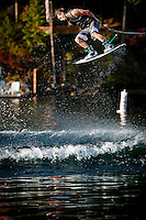 Matt Gencarella rotates while flying over the waters of Hayden Lake in Idaho.