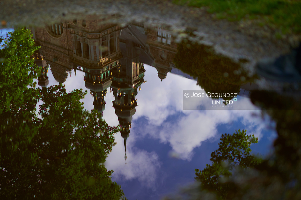 Reflection Of Nordiska museet (Museum) On Puddle in Stockholm