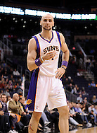 Dec. 17, 2012; Phoenix, AZ, USA; Phoenix Suns center Marcin Gortat (4) reacts on the court during the game against the Sacramento Kings in the first half at US Airways Center. Mandatory Credit: Jennifer Stewart-USA TODAY Sports