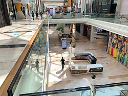 © Licensed to London News Pictures. 15/06/2020. London, UK.  Westfield shopping centre in west London remains mainly empty on the first day of opening after Lockdown forced closure. Government has introduced further measures to allow non-essential shops and services to reopen under social distancing conditions. Photo credit: Ben Cawthra/LNP