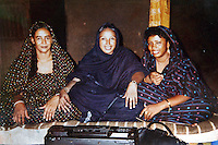 Niger,Agadez,2007. A re-photographed Polaroid from the family collection. On the left is Aissa Hamini, Mohammad Ixa's first wife, at the wedding of a friend.