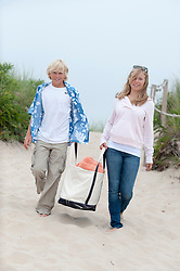 boy and girl carrying a beach bag together on the beach in East Hampton, NY
